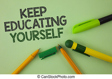 Handwriting text writing Keep Education Yourself. Concept meaning Learning skills with your own competencies written on Plain Green background Pens next to it.