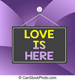 Handwriting text writing Love Is Here. Concept meaning ...