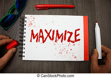 Handwriting text writing Maximize. Concept meaning Increase to the greatest possible amount or degree Make larger Googles glasses pen marker cap notepad notebook highlighter eye sight.