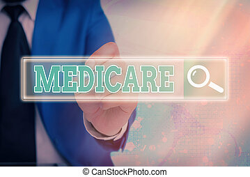 Handwriting text writing Medicare. Concept meaning a policy of the federal government providing health care coverage Web search digital information futuristic technology network connection.