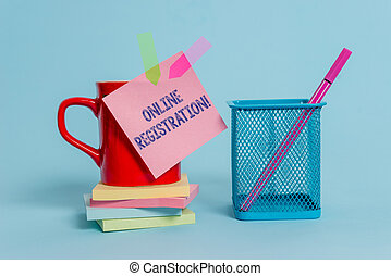 Handwriting text writing Online Registration. Concept meaning Process to Subscribe to Join an event club via Internet Cup note arrow banners stacked pads metal pen holder pastel background.