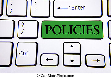 Handwriting text writing Policies. Concept meaning Business Company or Government Rules Regulations Standards written on Green Key Button on White Keyboard with copy space. Top view.