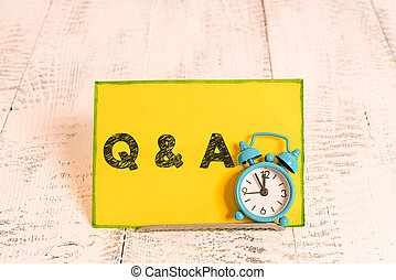 Handwriting text writing Q And A Question. Concept meaning in which demonstrating asks questions and another one answers them.