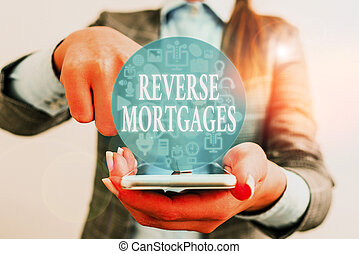 Handwriting text writing Reverse Mortgages. Conceptual photo borrower to access the unencumbered value of the property