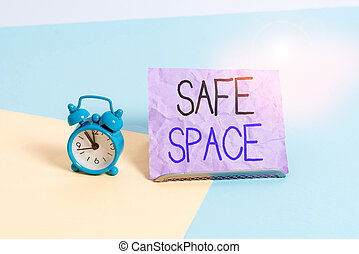 Handwriting text writing Safe Space. Concept meaning a place or room in which you are protected from harm or danger Mini size alarm clock beside a Paper sheet placed tilted on pastel backdrop.