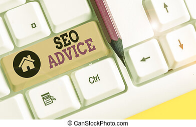 Handwriting text writing Seo Advice. Concept meaning guidance or recommendations in enhancing the search engine White pc keyboard with empty note paper above white background key copy space.