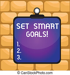Handwriting text writing Set Smart Goals. Concept meaning list to clarify your ideas focus efforts use time wisely Clipboard colorful background spring clip stuck bind empty plank frame.