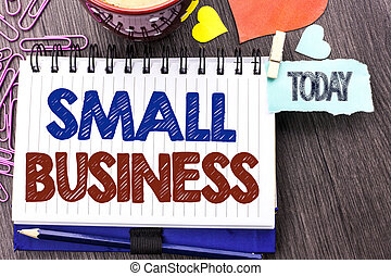 Handwriting text writing Small Business. Concept meaning Little Shop Starting Industry Entrepreneur Studio Store written on Notebook Book on the Wooden background Today Hearts Pins next to it.