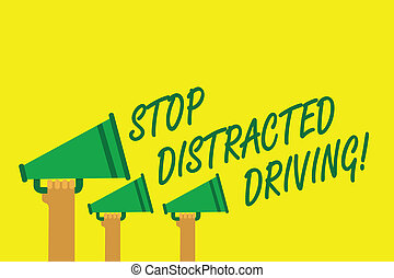 Handwriting text writing Stop Distracted Driving. Concept meaning asking to be careful behind wheel drive slowly Hands holding megaphones loudspeakers important message yellow background.