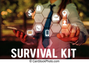 Handwriting text writing Survival Kit. Concept meaning Emergency Equipment Collection of items to help someone.