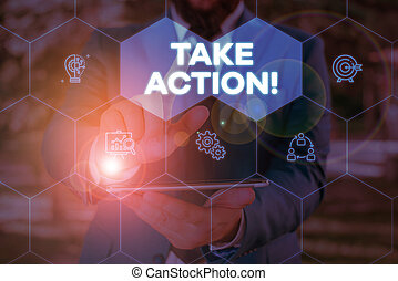 Handwriting text writing Take Action. Concept meaning do something official or concerted to achieve aim with problem Male human wear formal work suit presenting presentation using smart device.