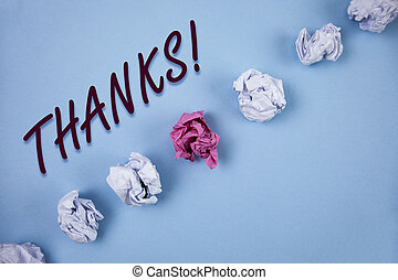 Handwriting text writing Thanks Motivational Call. Concept meaning Appreciation greeting Acknowledgment Gratitude written on Plain Blue background Crumpled Paper Balls next to it.