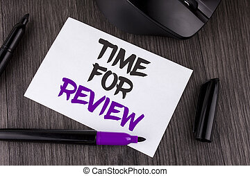 Handwriting text writing Time For Review. Concept meaning Giving Feedback Evaluation Rate job test or product Qualify written on White Sticky Note Paper on the wooden background Mouse Markers