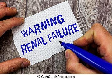 Handwriting text writing Warning Renal Failure. Concept...