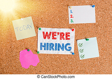 Handwriting text writing We Re Hiring. Concept meaning recently employ someone or pay him to do particular job Corkboard color size paper pin thumbtack tack sheet billboard notice board.