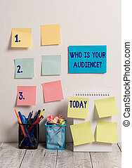 Handwriting text writing Who Is Your Audience Question. Concept meaning who is watching or listening to it 10 Sticky Notes Card on Wall Spiral Notebook 2 Pencil Pots on Work Desk.