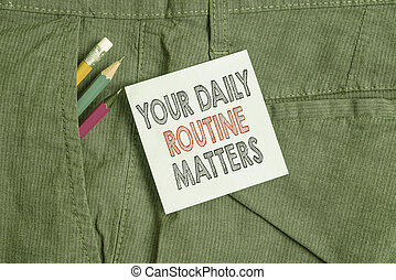 Handwriting text Your Daily Routine Matters. Concept meaning practice of regularly doing things in fixed order Writing equipment and blue note paper inside pocket of man work trousers.