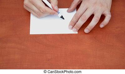 Handwritten 10% on white paper sheet