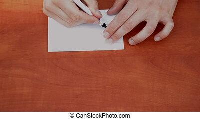 Handwritten 150% on white paper sheet