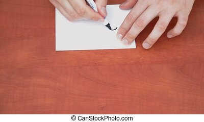Handwritten 20% on white paper sheet