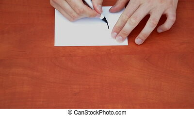 Handwritten 50% on white paper sheet