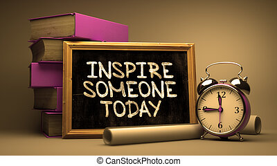 Handwritten Inspire Someone Today on a Chalkboard....