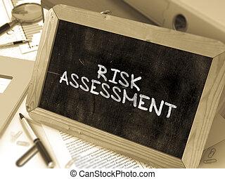 Handwritten Risk Assessment on a Chalkboard.