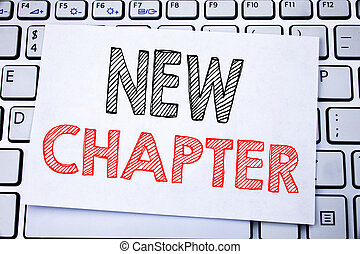 Handwritten text caption showing New Chapter. Business concept writing for Starting New Future Life written on sticky note paper on the white keyboard background.