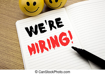Handwritten text caption showing We Are Hiring Now. Business concept writing for Recruitment Human Resources written on notebook with copy space on book background with marker pen