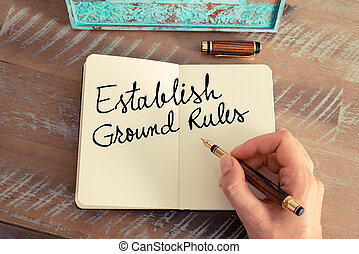 Handwritten text Establish Ground Rules as concept image. ...