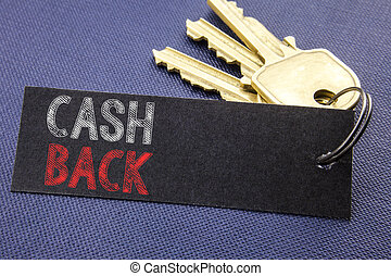 Handwritten text showing Cash Back Cashback. Business concept writing for Money Assurance Written on note paper attached to the key, black background with space close up