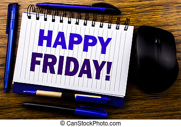 Handwritten text showing Happy Friday . Business concept for Weekend Welcoming written on notebook book note paper on the wooden background. Blue word letters. Next to mouse.
