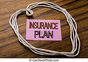 Handwritten text showing Insurance Plan. Business concept for Health Life Insured written on sticky note paper on the dark wooden background. With heart meaning love or adoration.