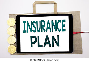 Handwritten text showing Insurance Plan. Business concept writing for Health Life Insured Written on shopping bag and tablet with white background, tablet charging with cryptocurrency bitcoin.