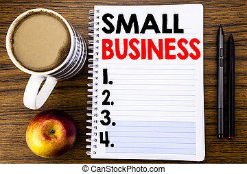 Handwritten text showing Small Business. Business concept for Family Owned Company written on notepad note paper on the wood structure background background.