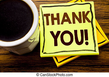 Handwritten text showing Thank You. Business concept for Thanks Message written on sticky note paper on the wooden wood background with coffee cup