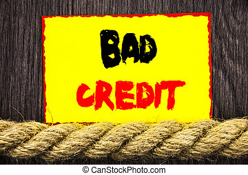 Handwritten text sign showing Bad Credit. Conceptual photo...