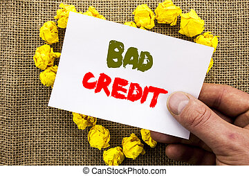 Handwritten text sign showing Bad Credit. Conceptual photo Poor Bank Rating Score For Loan Finance written on Sticky Note Paper With Heart Holding Hand with Finger.