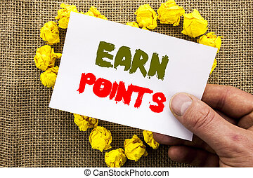 Handwritten text sign showing Earn Points. Conceptual photo Loyalty Reward Benefit Program For Earning Customer Point written on Sticky Note Paper With Heart Holding Hand with Finger.