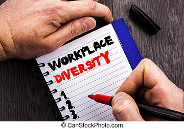 Handwritten text sign showing Workplace Diversity. Conceptual photo Corporate Culture Global Concept For Disability written on Notebook Book Man Writing Holding Pen wooden background.