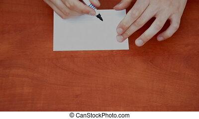 Handwritten USD on white paper sheet