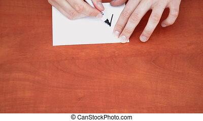 Handwritten word Agree on white paper sheet