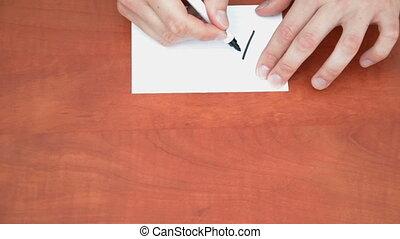 Handwritten word ASAP on white paper sheet
