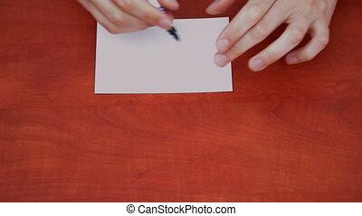 Handwritten word Check on white paper sheet