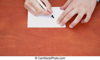 Handwritten word Crazy on white paper sheet
