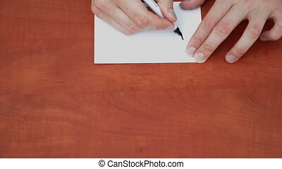 Handwritten word Exactly on white paper sheet