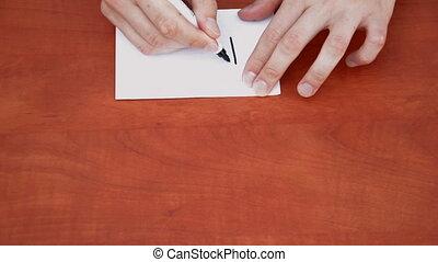 Handwritten word Find on white paper sheet