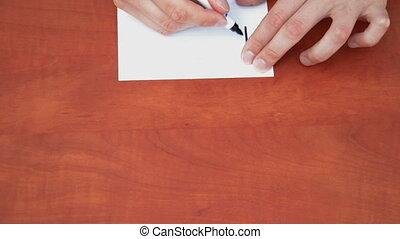 Handwritten word Forward on white paper sheet