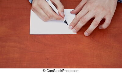 Handwritten word Hard on white paper sheet