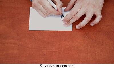 Handwritten word Instantly on white paper sheet